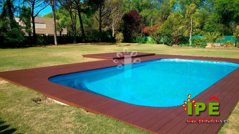 4 ejemplos de tarima de madera para piscinas ipe maderas for Climatizar piscina exterior